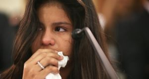 "Mayeli Hernandez who was forced to leave    Honduras as a 12-year-old due to increasing violence. Amnesty International governments paid lip-service to protecting civilians last year while ""failing miserably"". Photograph: Alex Wong/Getty"