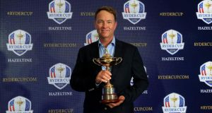 Davis Love III holds the Ryder Cup Trophy as he poses for the media during his announcement as the 2016 United States Ryder Cup Team Captain. Photograph: David Cannon/Getty Images