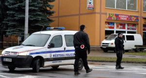 Police officers patrol near a restaurant where a gunman opened fire in Uhersky Brod. Photograph: Reuters
