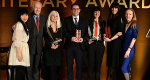 The judges and the winners: (From left) Judges Xiaolu Guo, Ciaran Carty, Paula Meehan (Hall of Fame). Simon Lewis (Emerging Poetry winner), Sara Baume (Emerging Fiction and Writer of the Year winner), Henrietta McKervy (First Fiction winner) and  judge Martina Devlin, at the 44th Annual Hennessy Literary Awards which recognise and reward emerging Irish writers and poets in the literary sphere.  Photograph: Dara Mac Donaill / The Irish Times