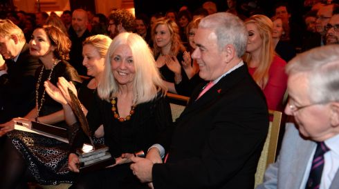 Paula Meehan, is congratulated by her partner Theo Dorgan, at the 44th Annual Hennessy Literary Awards.  Photograph: Dara Mac Donaill / The Irish Times