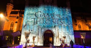 The 'Game of Thrones' logo is projected on to the Guildhall in London. The fifth season will premiere at the Tower of London next month. Photograph: Ian West / PA