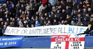 Chelsea fans hold an anti-racism banner during the English Premier League football match between Chelsea and Burnley at Stamford Bridge last weekend. Photograph: Olly Greenwood/Getty Images