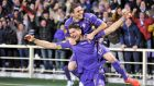 Fiorentina's Mario Gomez (front) celebrates with his team-mate Joaquin after scoring a goal against Spurs during the Europa League second leg at Artemio Franchi stadium in Florence. Photograph: Maurizio Degl'Innocenti
