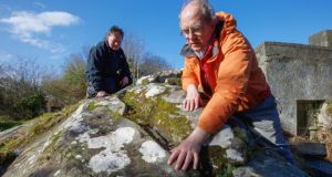Archaeologist Michael Gibbons and local historian Michael Moylan who found the new panel of rock art on the Boheh stone near Croagh Patrick in Co Mayo.  Photograph: Keith Heneghan.