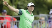 Rory Mcllroy gestures after hitting from the first tee. He shot a three-over-par 73. (AP Photo/Luis M. Alvarez)