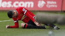 Manchester United striker Robin van Persie will miss next month's FA Cup tie with Arsenal after picking up an ankle injury in the 2-1 defeat away to Swansea City. Photograph: AFP