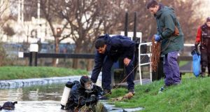 Garda divers searching the Grand Canal for Trevor in 2000. Photograph: Colin Keegan/Collins