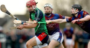 Lit's Martin Fitzgerald comes under pressure from Daire Quinn and Tony Kelly of UL. Photo: Inpho/James Crombie