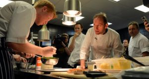 Mark Moriarty prepares a dish under the watchful Stephen Gibson (Pichet), Neil McFadden  and Marc Amand (La Rousse Foods) back in 2012. Photograph: Brenda Fitzsimons