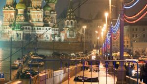 The body of Russian opposition leader Boris Nemtsov is covered with plastic lies on Moskvoretsky bridge near St. Basil cathedral  in central Moscow. Photograph: AFP