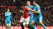 Manchester United's Radamel Falcao is challenged by Sunderland's John O'Shea and Wes Brown during the  Premier League match at Old Trafford. Photograph: Martin Rickett/PA