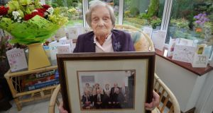 Madge Fanning celebrated being  100 years-old at her home in Skerries in May last year. She is holding a photograph of her with her siblings.Photograph: Alan Betson / The Irish Times