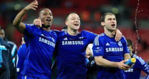 Didier Drogba, John Terry and Branislav Ivanovic celebrate Chelsea's League Cup final win over Spurs. Photograph: PA