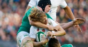 England's Billy Twelvetrees is tackled by Ireland's Tommy O'Donnel. Photograph: Cathal McNaughton/Reuters