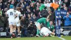 Robbie Henshaw celebrates scoring Ireland's  try with Conor Murray and a cast of thousands. Photo: Inpho/James Crombie