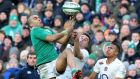 Simon Zebo competes for a high ball with George Ford during Sunday's action at the Aviva Stadium:  Ireland kicked the ball 44 times compared with England's 27.  Photograph: David Rogers/Getty Images