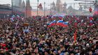 People carry Russian national flags during a march in Moscow in memory of opposition leader Boris Nemtsov, who was gunned down on Friday close to the Kremlin. Photograph: Dmitry Lovetsky/AP