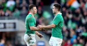 Robbie Henshaw celebrates with Conor Murray after his try Photo: Inpho/James Crombie