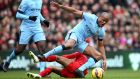 Liverpool's Phillippe Coutinho and Manchester City's Vincent Kompany  battle for the ball during the  Premier League match at Anfield.