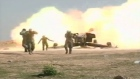 On the frontline: Iraqi forces attack Tikrit