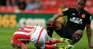 Stoke City's Stephen Ireland lies on the ground  after the tackle from Hull City's Maynor Figueroa, which left him needing 12-15 stitches. Photograph: Mike Egerton/PA Wire