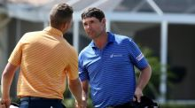 Padraig Harrington shakes hands with Daniel Berger on the second playoff hole during the continuation of the fourth round of The Honda Classic. Photograph: Sam Greenwood/Getty Images