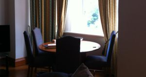 Dining area before staging: Dark spaces should be lit with lots of soft tone lighting and adding a mirror can bring more light to a dim room