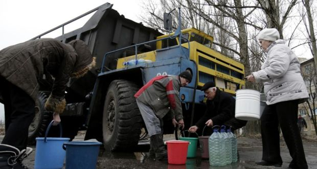Residents Fill Water Containers From A Tanker In The Eastern Ukrainian City Of Avdiivka