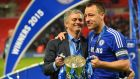 Chelsea manager Jose Mourinho with club captain John Terry following the League Cup final win over Tottenham at Wembley. Photo: Glyn Kirk/AFP