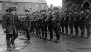 Military objective: Richard Mulcahy – here inspecting soldiers in Dublin – argued that permitting official executions would prevent National Army troops from carrying out unofficial killings. Photograph: Walshe/Topical/Getty