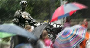 Tourists take in the Molly Malone statue in College Green, Dublin.  Photograph by Matt Kavanagh/The Irish Times