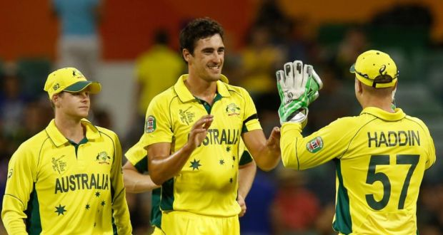 79cd34df4 Australia s Mitchell Starc celebrates with teammates after dismissing  Afghanistan s Zadran Najibullah during their Cricket World Cup