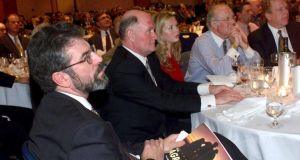 Sinn Féin president Gerry Adams listens from his table as he is introduced at a fundraiser in New York in 1999. Seated next to Adams is businessman Pat Donaghy, a major donor.