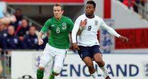 Republic of Ireland midfielder Glenn Whelan holds off the challenge of England's   Daniel Sturridge during the friendly international  at Wembley Stadium in May 2013. Photograph: Donall Farmer/Inpho