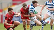 Rockwell's Lee Molloy is tackled by Glenstal's George O'Hara during the  Munster Schools Senior Cup semi-final at Thomond Park. Photograph: James Crombie/Inpho