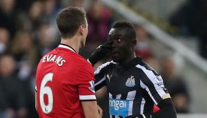 Manchester United's Jonny Evans clashes with Newcastle's Papiss Cisse. Photograph: Lee Smith/Reuters