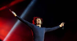 Gary Lightbody of Snow Patrol performing in the Phoenix Park, Dublin, in 2012.  The Northern Ireland  band's  drummer Jonny Quinn has credited pop star Ed Sheeran for teaching  Lightbody and the rest of the band how to use  Twitter when he toured as their support act in North America that year.  Photograph: Aidan Crawley/The Irish Times