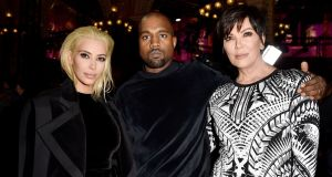 Kim Kardashian attended Paris Fashion Week with a brand new bleached blonde hairddo, with Kanye West and Kris Jenner.  Getty Images