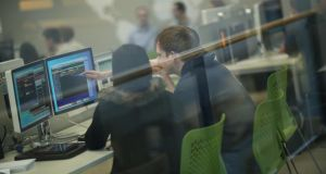 Students following the market at the business school trading room in UCD