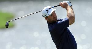 Graeme McDowell of Northern Ireland hits his second shot on the 10h hole during the first round of the World Golf Championships-Cadillac Championship at Trump National Doral Blue Monster Course on Thursday. Photograph: David Cannon/Getty Images.