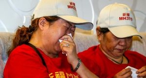 Chinese relatives of missing Malaysia Airlines Flight MH370 passengers crying during press conference at a hotel in Seri Petaling near Kuala Lumpur, Malaysia. Photograph: EPA