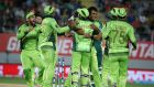 Rahat Ali is mobbed by his Pakistan team-mates. Photograph: AFP