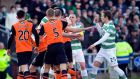 Dundee United were reduced to nine-men but held out to take Celtic to a Scottish Cup quarter-final replay after their 1-1 draw at Tannadice. Photograph:  Craig Halkett/PA Wire.