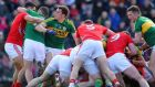 Cork and Kerry players get involved in a melee  during the  Allianz League Division One clash at Páirc Uí Rinn. Photograph: Cathal Noonan/Inpho