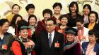 Chinese prime minister Li Keqiang   poses with female delegates to mark  International Women's Day. Photograph: China Daily/Reuters