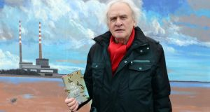 Paul Durcan in front of a mural in Sandymount: in Breaking News, the poet recalls the final conversation between himself and Seamus Heaney on Sandymount strand. Photograph: Cyril Byrne