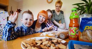 Dagmara Dopierala with her two children, Ian (3) and Aidan (4), and her mother Iwona making some Polish food.  Photograph: Alan Betson