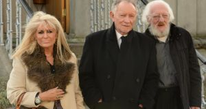 Geraldine Branagan, Phil Coulter and Eamonn Campbell at the funeral at Mount Jerome, Dublin. Photograph: Cyril Byrne