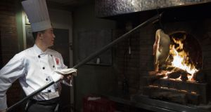 Enjoy a classic Beijing specialty at Duck de Chine.  Photograph: Adam Dean/The New York Times